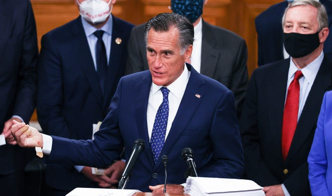 Sen. Mitt Romney, R-Utah, speaks alongside a bipartisan group of Democrat and Republican members of Congress as they announce a proposal for a COVID-19 relief bill on Capitol Hill on Dec. 14, 2020, in Washington.