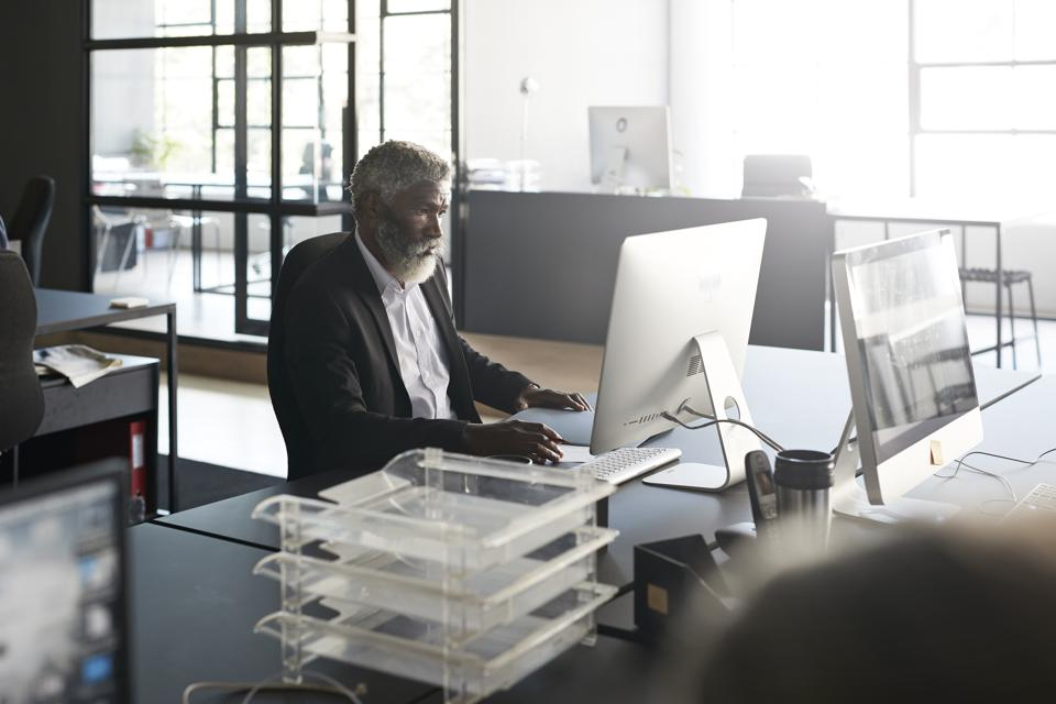 Businessman working over computer at workplace